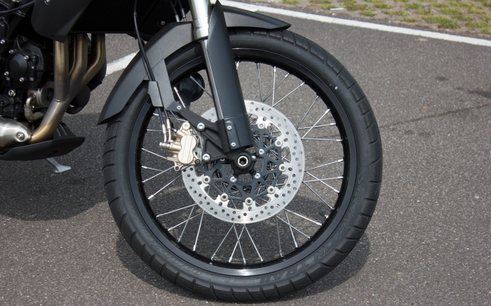 "The 21"" spoked front wheel ruins handling and brakes"