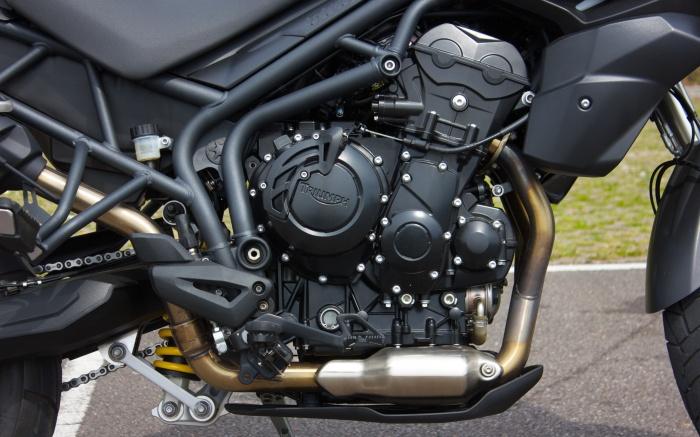 The 800cc triple is a long-stroke, softly tuned Street Triple motor
